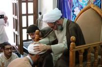مراسم عمامه گذاری طلاب حوزه علمیه لاهیجان با حضور آیت الله فلاحتی