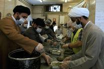 توزیع 4 هزار پرس غذای گرم و 2 هزار بن خرید نان در بین نیازمندان