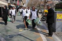 پاکسازی خیابان ولیعصر از زبالهها در روز جهانی کار داوطلبانه توسط مردم